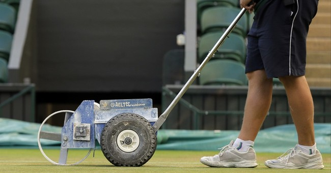 Every morning, they mow, paint, mop Wimbledon's grass courts