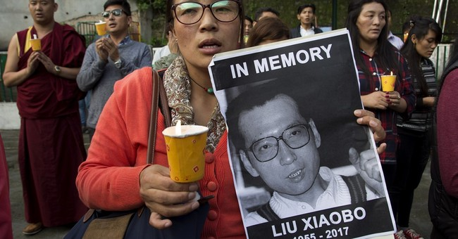 The Latest: Liu Xiaobo's body cremated in private ceremony