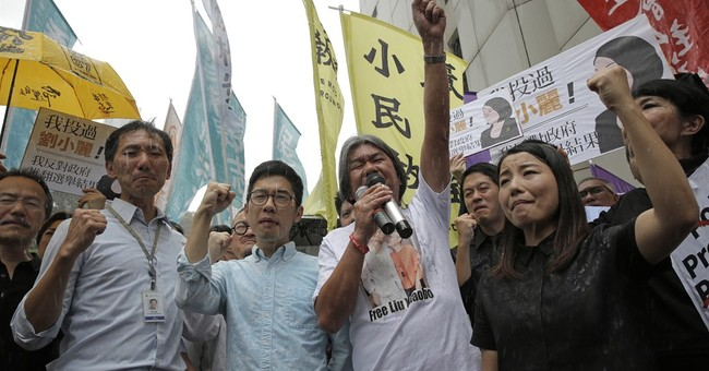 Hong Kong court disqualifies 4 lawmakers over oath taking