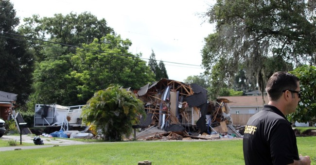 Sinkhole stops growing after swallowing 2 houses in Florida