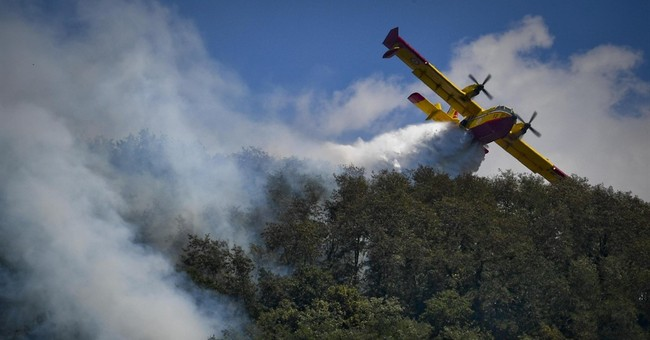 Italy wildfires force evacuations, cause disruption