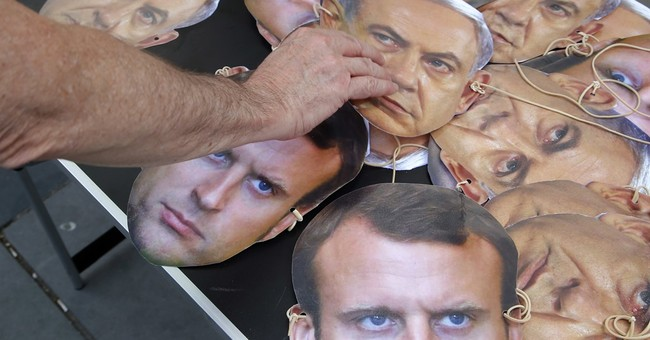The Latest: Macron calls for new Israeli-Palestinian talks