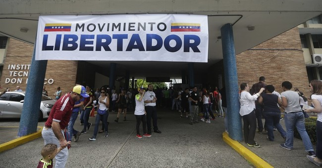 The Latest:  Venezuelan opposition says 7.1 million voted