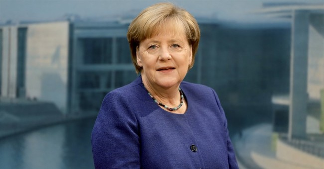 Merkel ally renews refugee cap demand, but avoids threats