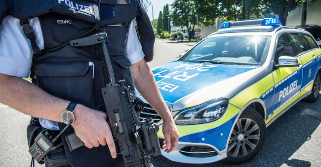 German police hunting armed man after he shows up at school