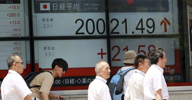 Asian shares mostly higher as focus turns to central bankers