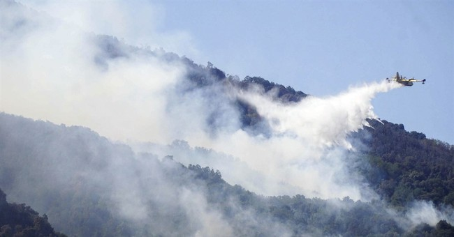 The Latest: Portugal starting to bring fires under control