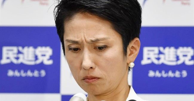 Japan lawmaker shows legal records to prove nationality