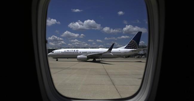 United Continental's 2Q profit tops Wall Street forecasts