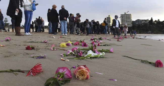 Mourners hold Sydney beach vigil for woman shot by US police