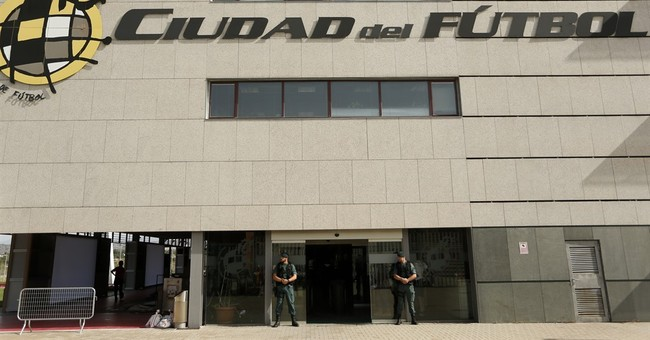 The Latest: Spanish soccer body cancels meetings amid crisis