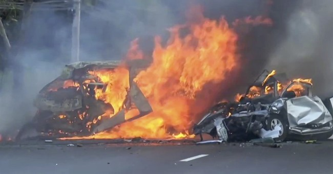 Van, truck collide, catch fire on Thai highway, killing 25