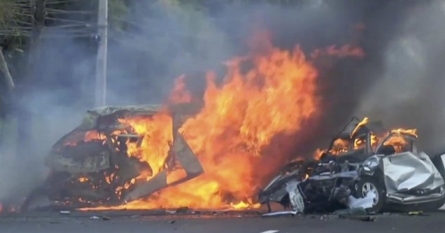 Van, truck collide, catch fire on Thai highway, killing 25