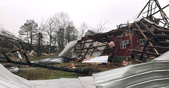 The Latest: Authorities: Georgia woman killed in storms