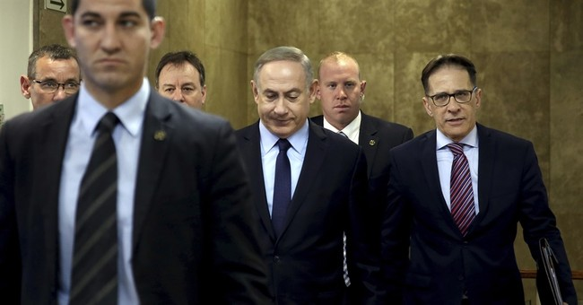 Israeli leader denies wrongdoing after police grilling