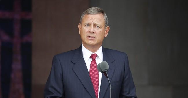 Roberts, target of Trump jabs, meeting Trump at Capitol