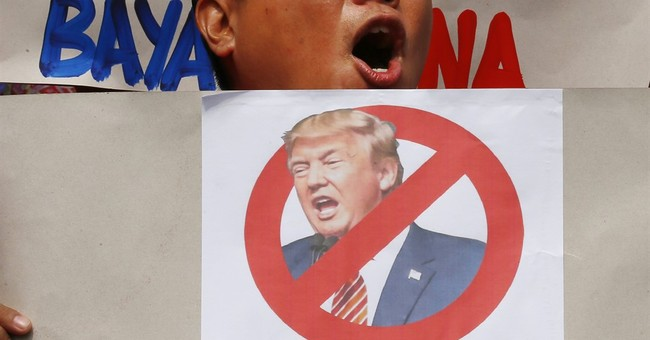Philippine protesters ask Duterte to stay away from Trump