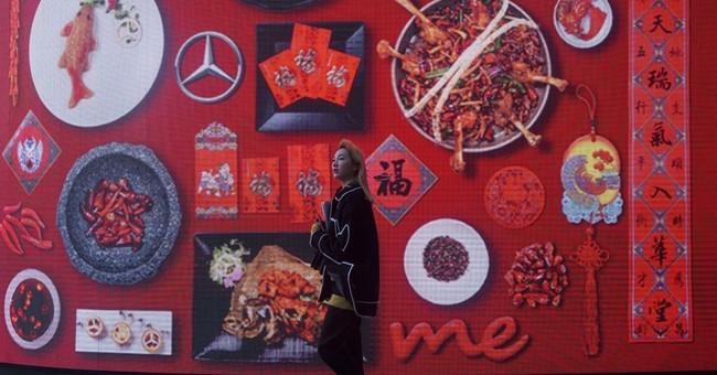 China's growth in 2016 slumps as Trump trade struggle looms
