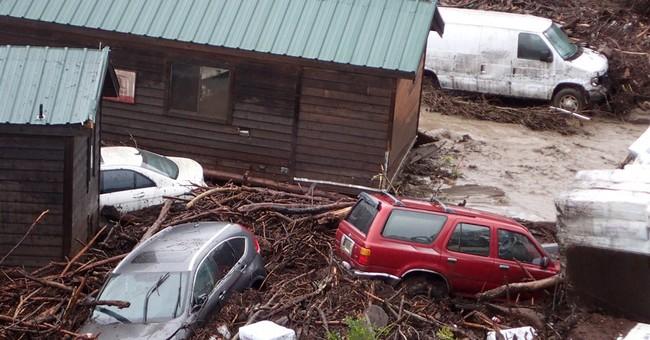 California flood sweeps cabins, cars down coastal canyon