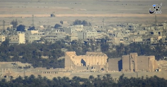 IS in Syria destroys part of Roman theater in Palmyra