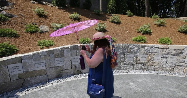 The Latest: Descendants remember victims of witch trials