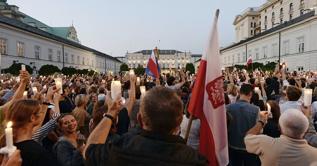 European Union warns Poland over judicial reforms as thousands protest