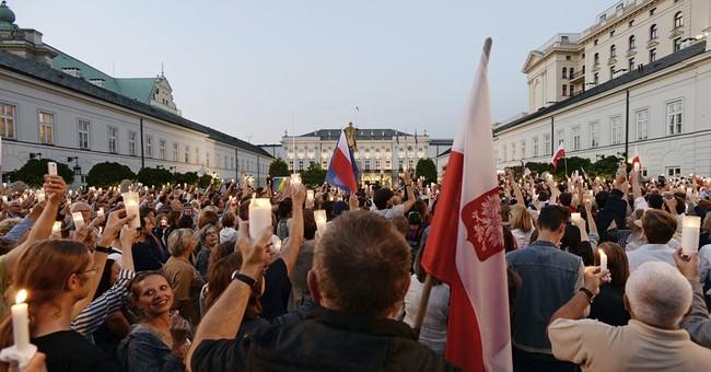 European Union warns Poland over judicial reforms as thousands protest