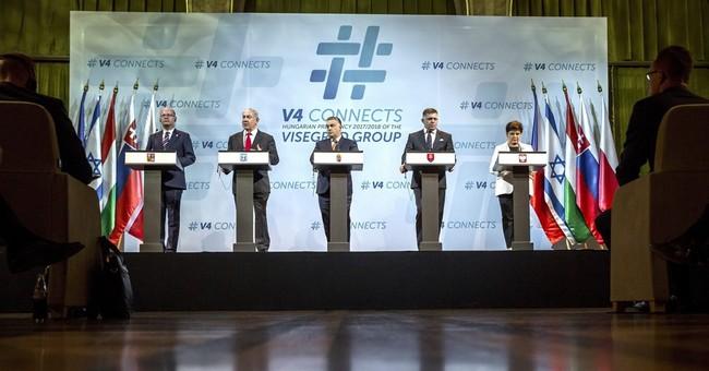 On hot mic, Israeli PM raps 'crazy' EU, admits Syria strikes