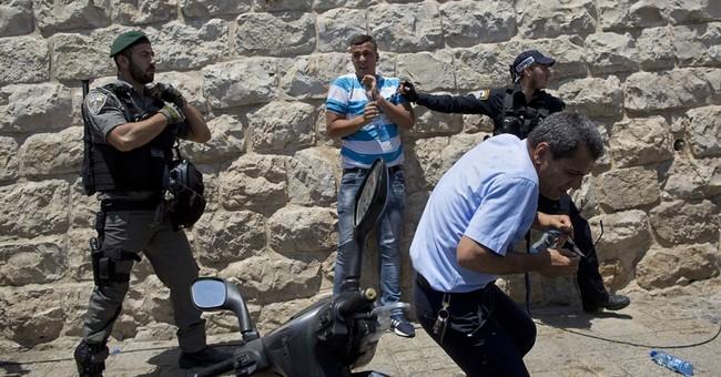 Israel signals metal detectors to stay at Jerusalem shrine