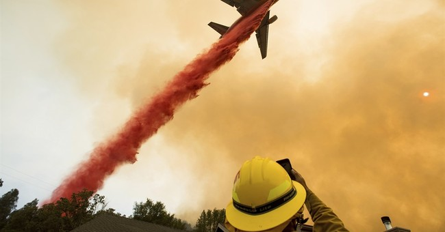 The Latest: California wildfire destroys 50 homes