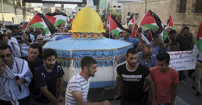The Latest: Palestinians, Israeli police clash in Jerusalem