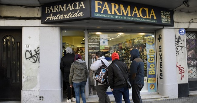 The Latest: Legal pot sales begin in Uruguay under 2013 law