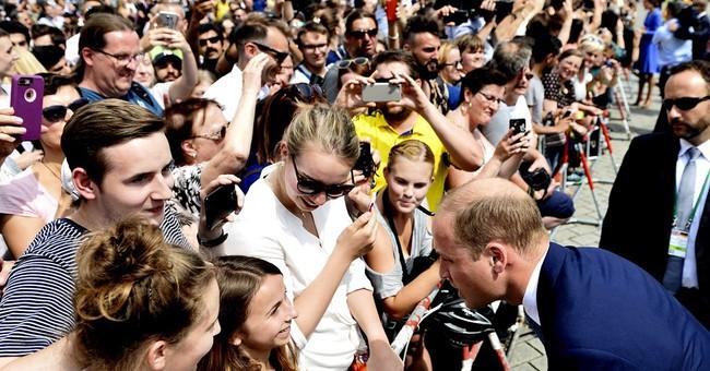 British royals meet Merkel, tour Berlin Holocaust memorial