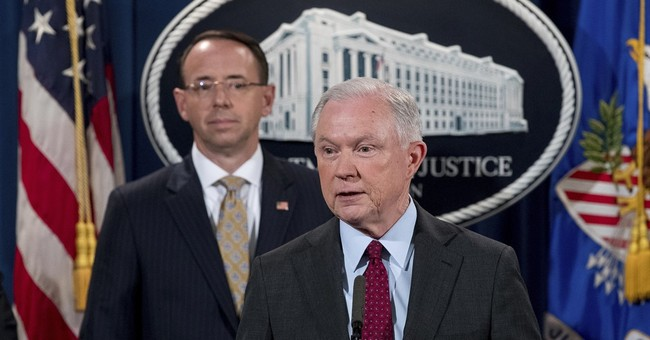 Publicly assailed by Trump, Sessions says he's staying on