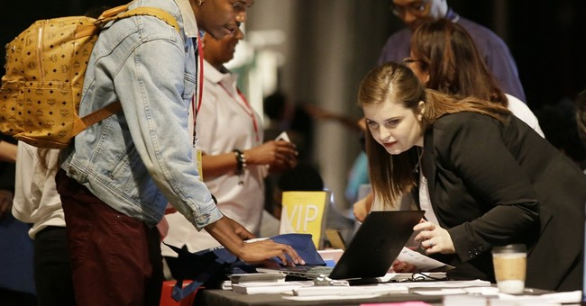US weekly requests for jobless aid fall to 233,000