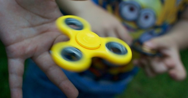 Fidget spinners as campaign goodies? Russia probes claims