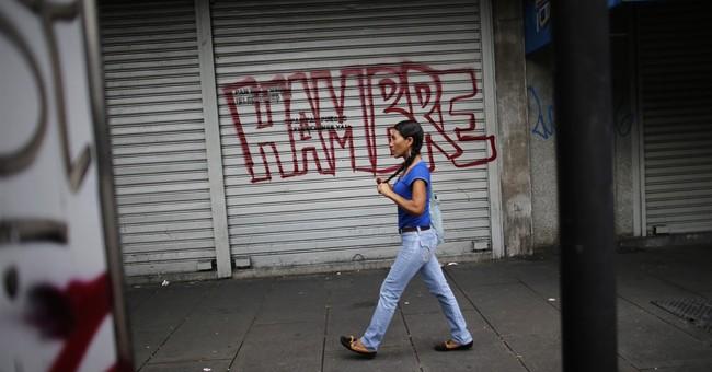 Venezuela strike erupts into violence leaving 2 dead