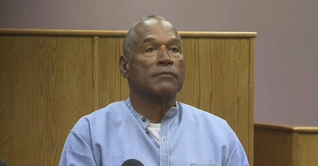 O.J. Simpson triumphant, others devastated as he gets parole