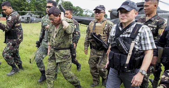 Duterte flies to besieged city, warns of other attacks