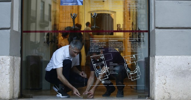 The Latest: Experts remove biological samples from Dali