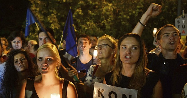 The Latest: Anti-govt protesters march in Polish cities