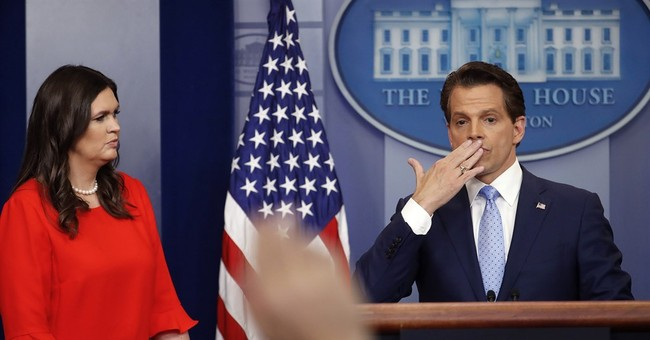 Spicer exits as Trump shakes up his beleaguered press team