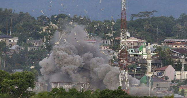 IS galvanized in Asia by Philippine city siege, report says