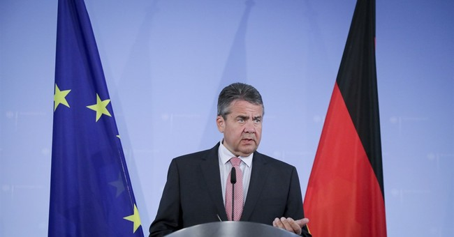 Turkish PM calls for cool heads as Germany tightens stance