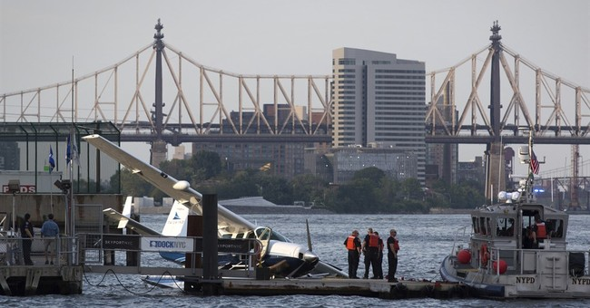 Small seaplane makes hard landing in NY's East River.