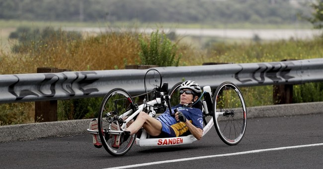 Endurance athlete overcomes paralysis to race, coach again