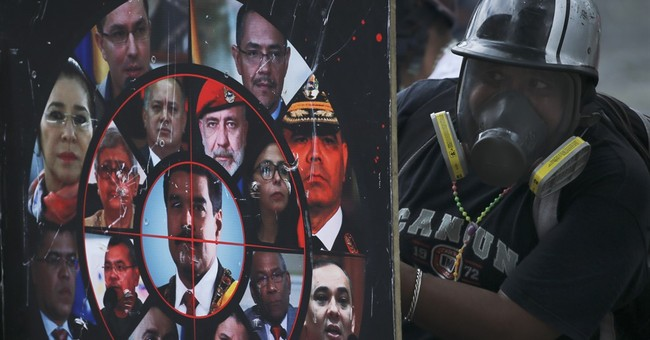 Venezuelans protest Maduro's plan to rewrite constitution