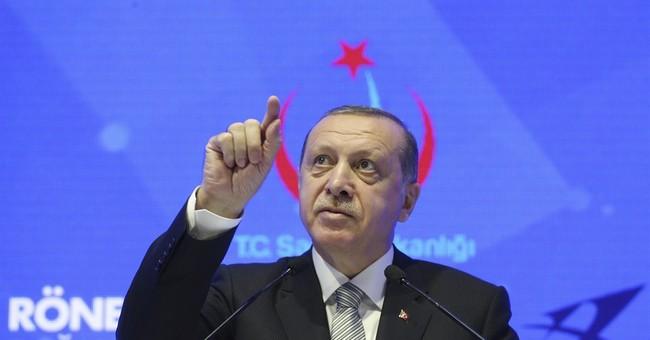The Latest: Turkey's president talks Qatar in Saudi, Kuwait