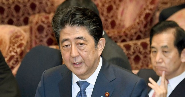Lawmakers accuse Japan's Abe of false testimony in scandal