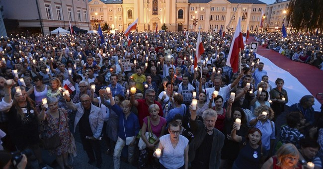 Poles protest EU comments and govt moves against top court